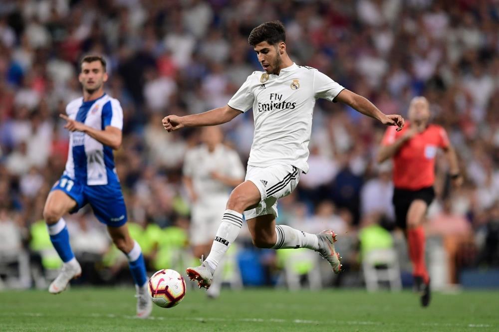 ريال مدريد يتخطى إسبانيول ويتصدر الليغا مؤقتا